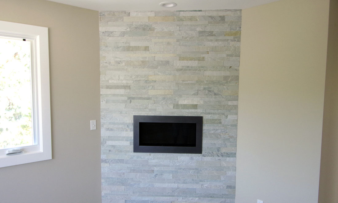 Tile Plus installs tile on fireplace mantels